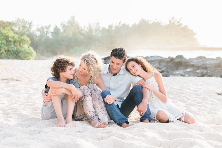 Family Photographers Memphis TN family sitting on beach hugging