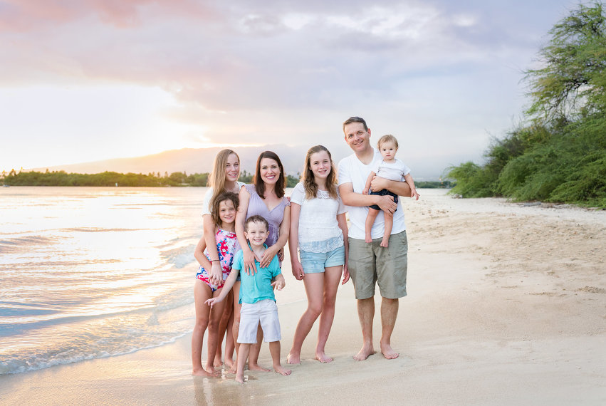Oahu Family Photographers Of Seven Standing On The Beach