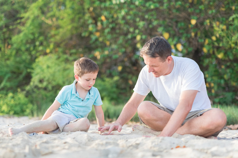 Family Photographers Memphis TN dad and found son playing on beach