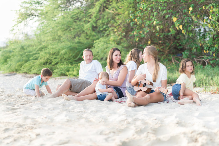 Family Photographers Memphis TN family of seven sitting on the beach