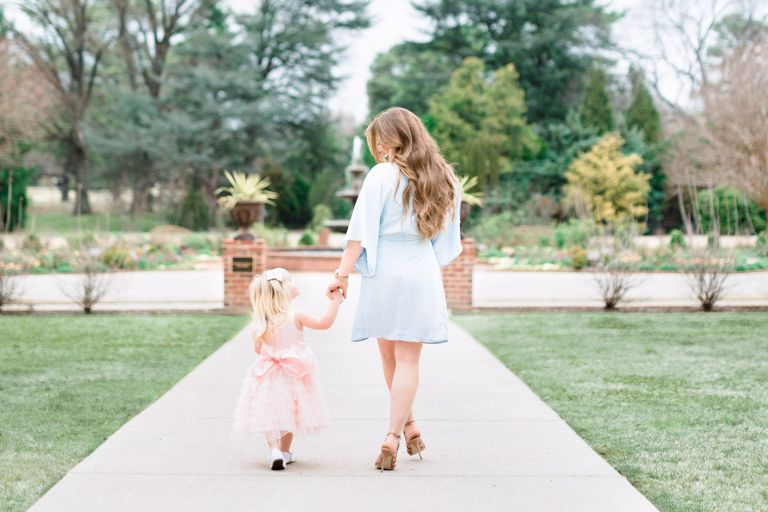 Best Photographers on Oahu Hawaii Celebrate Motherhood Mommy and Me Photo Session | Mom and daughter walking in garden