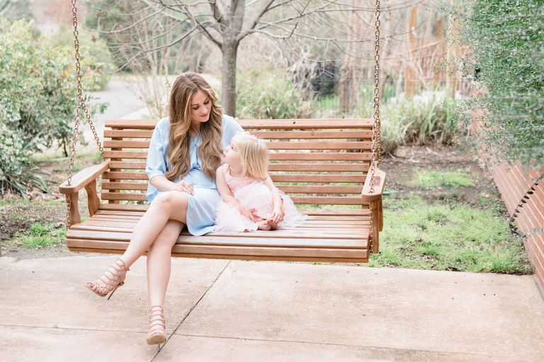 Best Family Photographers | Oahu Photographers | Celebrate Motherhood Mommy and Me Photo Session | mother and little daughter on porch swing