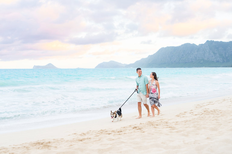 Best Couples Photographer on Oahu, Hawaii | Honeymoon Couple walking dog on Oahu beach with mountains in background
